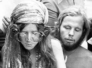Janis Joplin & David Niehaus on Copacabana Beach in Brazil, 1970, where Janis was surrounded by, and talking with, reporters.